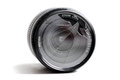 Close up of a broken camera lens, on a white. Royalty Free Stock Photo