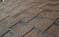 Close up on brown asphalt shingles roof. Roofing Construction Royalty Free Stock Photo