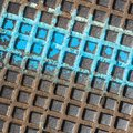 Close - up of a brown and blue manhole cover Royalty Free Stock Photo