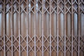 Close up brown metal grille sliding door. Royalty Free Stock Photo
