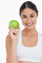 Close-up a brunette holding an green apple Royalty Free Stock Photo