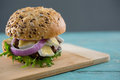 Close up of burger with cottage cheese on cutting board Royalty Free Stock Photo
