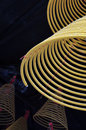 A close up of burning incense coils Stock Image