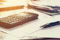 Close up business concept, Pen on summary report and calculator Royalty Free Stock Photo