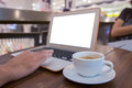 Close up of business man hand working on blank screen laptop computer in cafe blur or blurred soft focus Royalty Free Stock Photo