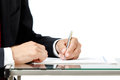 Close up of business man signing a contract on white background Stock Photo