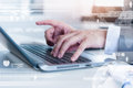 Close up of business man typing on laptop computer Royalty Free Stock Photo