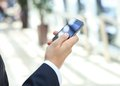 Close up of a business man using mobile smart phone Royalty Free Stock Image
