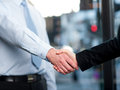 Close up of business people handshaking successful shaking hands after closing a deal Royalty Free Stock Image