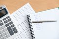 Close up of business stationery lying on the table notebook pen calculator and some documents Stock Photo