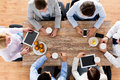 Close up of business team drinking coffee on lunch Royalty Free Stock Photo