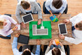 Close up of business team with project layout Royalty Free Stock Photo