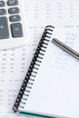Close up of business writing pad, pen, calculator Royalty Free Stock Photo