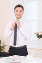 Close up of businessman adjusting neck tie waist handsome guy putting on Royalty Free Stock Photos