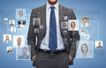Close up of businessman over icons with contacts corporate business people and cooperation concept blue background Stock Photography