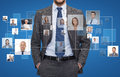 Close up of businessman over icons with contacts corporate business people and cooperation concept blue background Royalty Free Stock Images