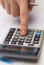 Close up of businessman with papers and calculator business office concept hand pressing button Stock Photo