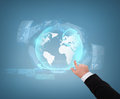 Close up of businessman pointing to globe hologram business and future technology concept Royalty Free Stock Images