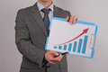 Close up of businessman showing  rising arrow, representing business growth. Manager showing presentation of progressive arrow cha Royalty Free Stock Photo