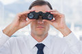 Close up of businessman using binoculars in his office Stock Images