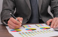 Close up of businessman working on  financial data in form of charts and diagrams. Business statistics and success concept Royalty Free Stock Photo