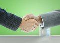 Close up of businessmen handshake in a green empty room Royalty Free Stock Photo