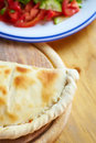 Close up calzone b closed italian pizza on the wood table Royalty Free Stock Image