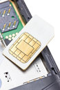 Close up of cell phone and sim card on white background Stock Photo