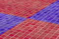 Close-up of ceramic floor made of red and blue glazed tile Royalty Free Stock Photo