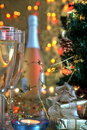 Close-up of champagne in glasses an gifts. Royalty Free Stock Photos