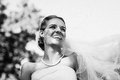 Close up of cheerful beautiful bride in park a young the Stock Photos