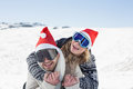 Close up of a cheerful couple in ski goggles on snow men and women covered landscape Stock Photos