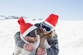 Close up of a cheerful couple in ski goggles on snow men and women covered landscape Royalty Free Stock Photo