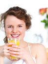 Close-up cheerful girl drinking juice Royalty Free Stock Photo