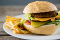 Close up of cheese burger with french fries Royalty Free Stock Photo