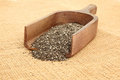 Close up of chia seeds in scoop wooden on burlap bag Stock Photos