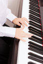 Close up of child hands playing the piano music and instrument concept Stock Images