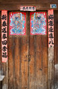 Close up of chinese doors with posters of gods to protect from the demons