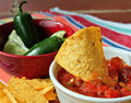 Close-up of Chips and Salsa and chile peppers Royalty Free Stock Photo