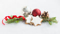 Close up of christmas homemade star cookies over white fluffy background. Christmas decoration. Royalty Free Stock Photo