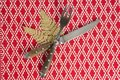 Christmas ornament with fork and butter knife on table cloth Royalty Free Stock Photo