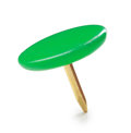 Close up of a circle green pushpin on white background Stock Image