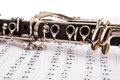 Close-up of clarinet and musical notes Royalty Free Stock Photo