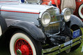 Close up classic car's stylish headlamps and grill Royalty Free Stock Photo