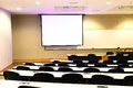 Close up on classroom, seat, table and projector screen Royalty Free Stock Photo
