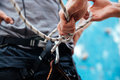 Close-up of climber putting on safety harness climbing equipment Royalty Free Stock Photo