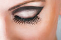 Close up of closed beautiful eye with long sexy false lashes Royalty Free Stock Photos