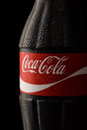 Close up of Coca-Cola classic bottle with drops Royalty Free Stock Photo