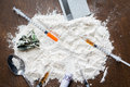 Close up of cocaine drug, money, spoon and syringe Royalty Free Stock Photo