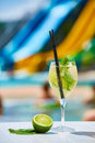 Close up Cocktail margaritas with lime near the swimming pool Royalty Free Stock Photo